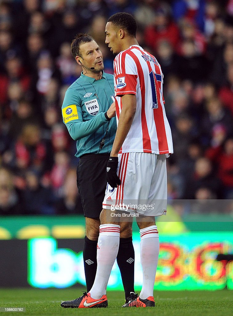 Steven Nzonzi of Stoke City is spoken to by referee Mark Clattenburg during the Barclays Premier League match between Stoke City and Southampton at Britannia Stadium on December 29, 2012 in Stoke on Trent, England.