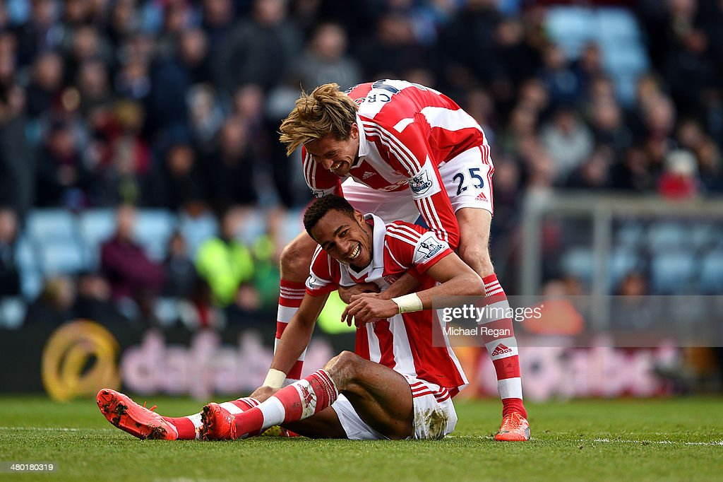 <a gi-track='captionPersonalityLinkClicked' href=/galleries/search?phrase=Steven+N%27Zonzi&family=editorial&specificpeople=6324480 ng-click='$event.stopPropagation()'>Steven N'Zonzi</a> of Stoke is congratulated by teammate <a gi-track='captionPersonalityLinkClicked' href=/galleries/search?phrase=Peter+Crouch&family=editorial&specificpeople=210764 ng-click='$event.stopPropagation()'>Peter Crouch</a> #25 after scoring his team's third goal during the Barclays Premier League match between Aston Villa and Stoke City at Villa Park on March 23, 2014 in Birmingham, England.