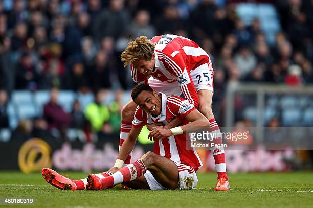 Steven N'Zonzi of Stoke is congratulated by teammate Peter Crouch after scoring his team's third goal during the Barclays Premier League match...