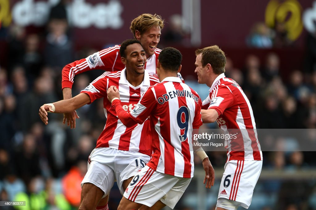 <a gi-track='captionPersonalityLinkClicked' href=/galleries/search?phrase=Steven+N%27Zonzi&family=editorial&specificpeople=6324480 ng-click='$event.stopPropagation()'>Steven N'Zonzi</a> (L) of Stoke is congratulated by teammates after scoring his team's third goal during the Barclays Premier League match between Aston Villa and Stoke City at Villa Park on March 23, 2014 in Birmingham, England.