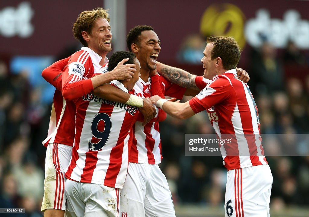 <a gi-track='captionPersonalityLinkClicked' href=/galleries/search?phrase=Steven+N%27Zonzi&family=editorial&specificpeople=6324480 ng-click='$event.stopPropagation()'>Steven N'Zonzi</a> (2nd R) of Stoke is congratulated by teammates after scoring his team's third goal during the Barclays Premier League match between Aston Villa and Stoke City at Villa Park on March 23, 2014 in Birmingham, England.