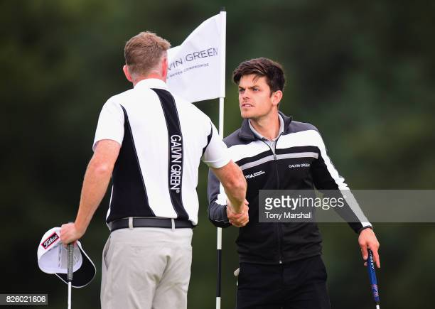 Steven O'Hara of North Lanarkshire Leisure Ltd shakes hands with Elliot Groves of Romsey Golf Club at the end of their second round during Day Two of...