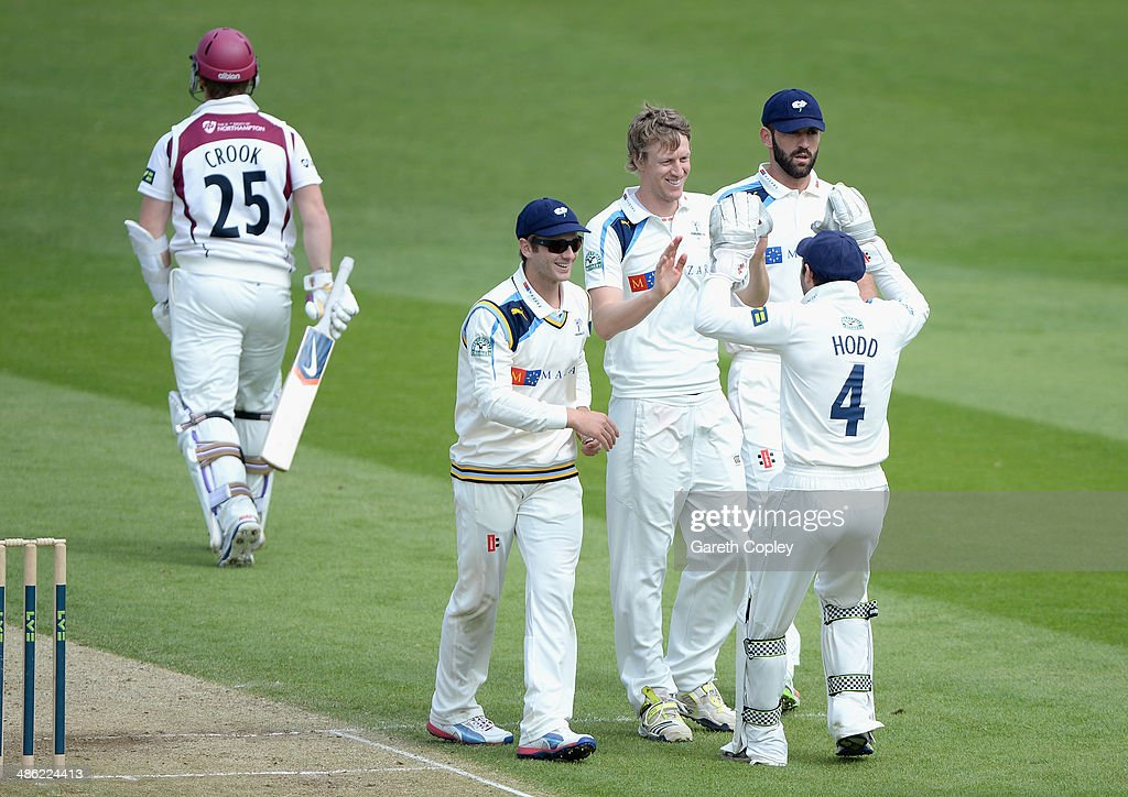 Steven Patterson of Yorkshire celebrates with teammates after dismissing Steven Crook of Northamptonshire during day four of the LV County Championship division One match between Yorkshire and Northamptonshire at Headingley on April 23, 2014 in Leeds, England.