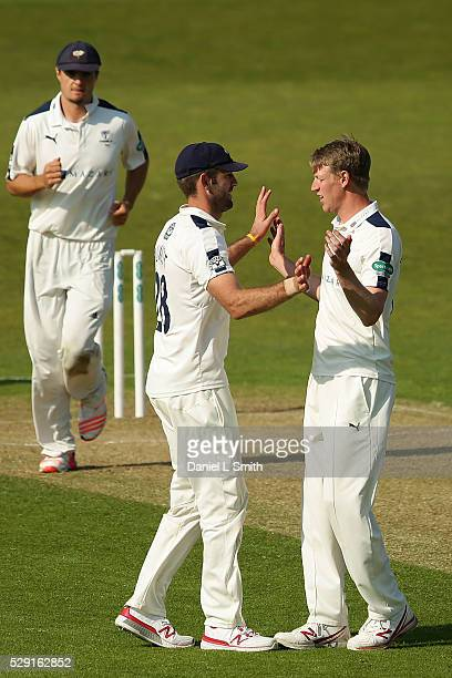 Steven Patterson of Yorkshire congratulates Liam Plunkett on catching Steve Davies of Surrey during the Specsavers County Championship Division One...