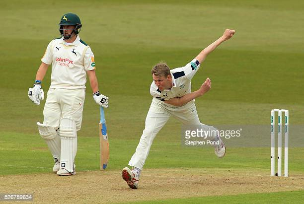 Steven Patterson of Yorkshire in action bowling during day one of the Specsavers County Championship Division One match between Nottinghamshire and...