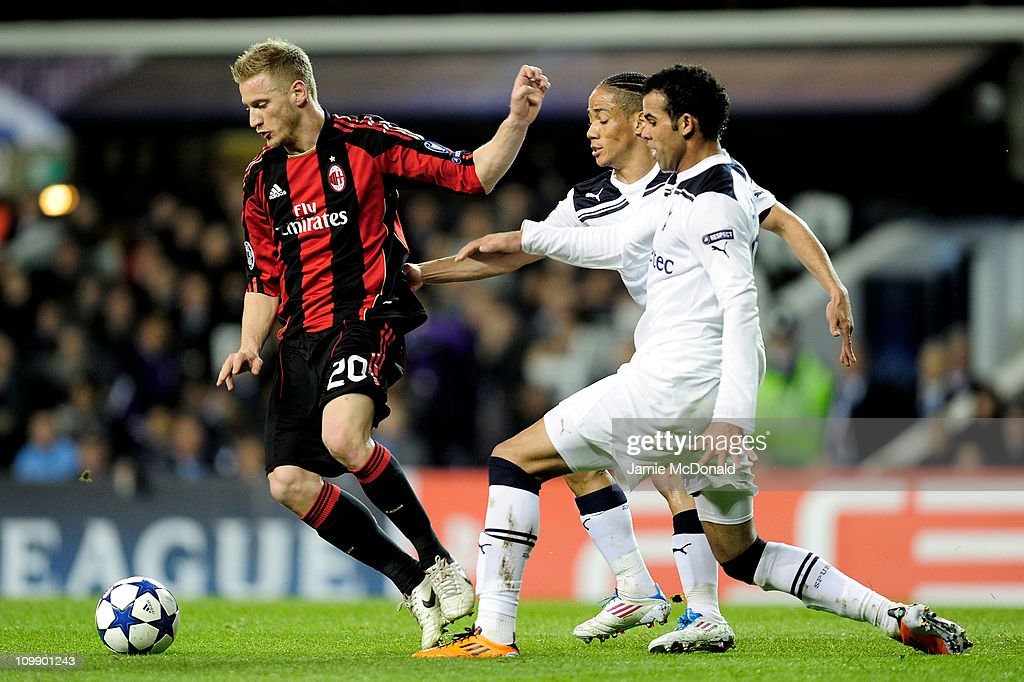 Steven Pienaar (2R) and Sandro (R) of Tottenham challenge Ignazio Abate of Milan during the UEFA Champions League round of 16 second leg match between Tottenham Hotspur and AC Milan at White Hart Lane on March 9, 2011 in London, England.