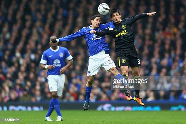 Steven Pienaar of Everton challenges Ryo Miyaichi of Wigan Athletic during the FA Cup Sixth Round match between Everton and Wigan Athletic at...