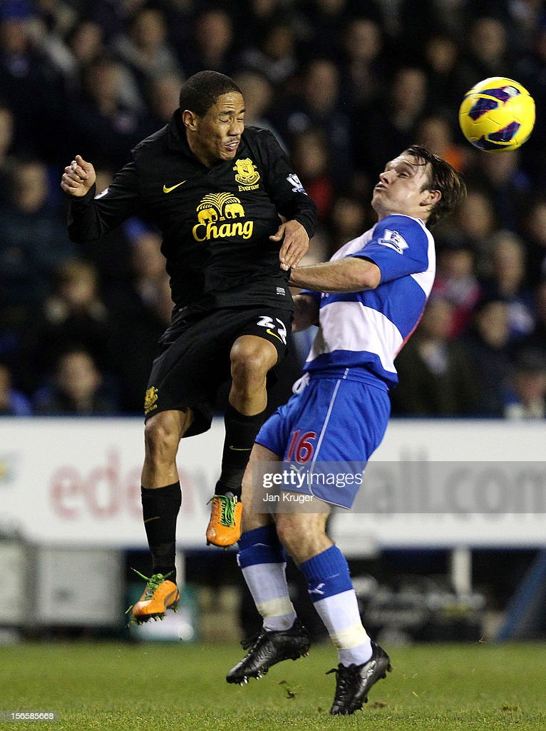 <a gi-track='captionPersonalityLinkClicked' href=/galleries/search?phrase=Steven+Pienaar&family=editorial&specificpeople=787271 ng-click='$event.stopPropagation()'>Steven Pienaar</a> of Everton competes for the arial ball with <a gi-track='captionPersonalityLinkClicked' href=/galleries/search?phrase=Jay+Tabb&family=editorial&specificpeople=638761 ng-click='$event.stopPropagation()'>Jay Tabb</a> of Reading during the Barclays Premier League match between Reading and Everton at Madejski Stadium on November 17, 2012 in Reading, England.