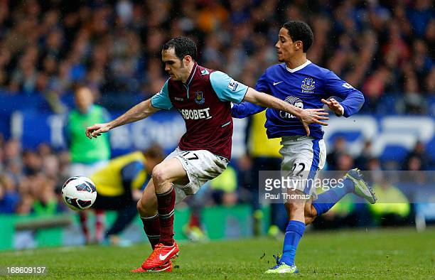 Steven Pienaar of Everton in action with Joey O'Brien of West Ham during the Barclays Premier League match between Everton and West Ham United at...