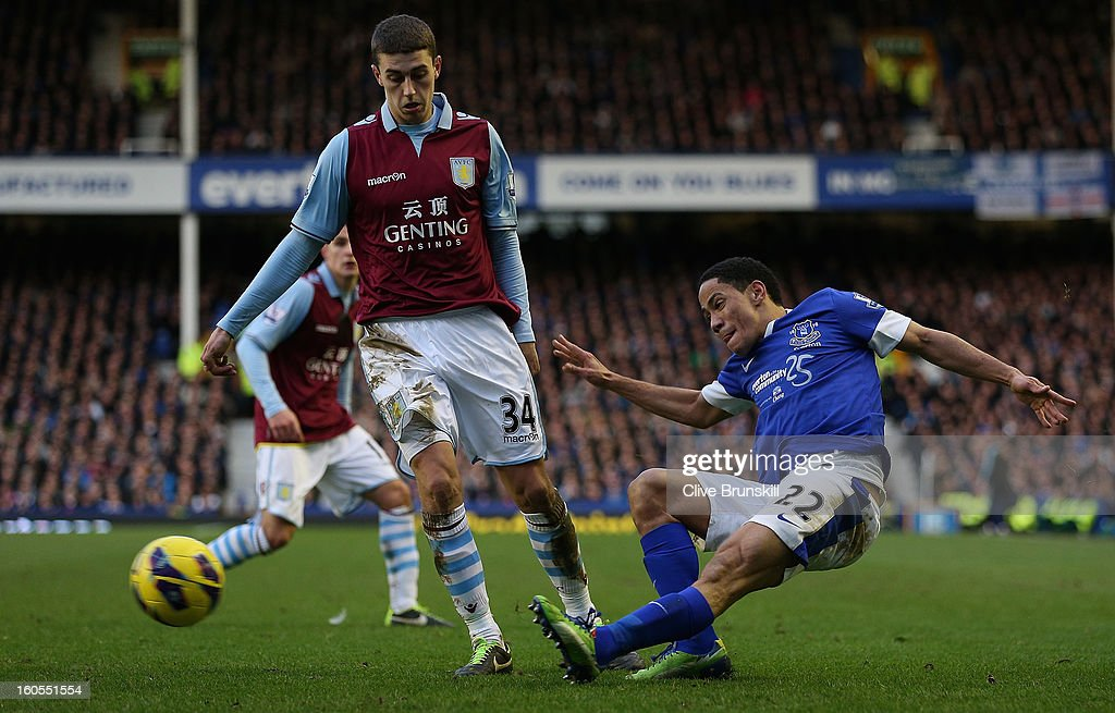 Steven Pienaar of Everton in action with Matthew Lowton of Aston Villa during the Barclays Premier League match between Everton and Aston Villa at Goodison Park on February 2, 2013 in Liverpool, England.