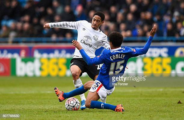 Steven Pienaar of Everton is challenged by Brandon Comley of Carlisle United during the Emirates FA Cup Fourth Round match between Carlisle United...