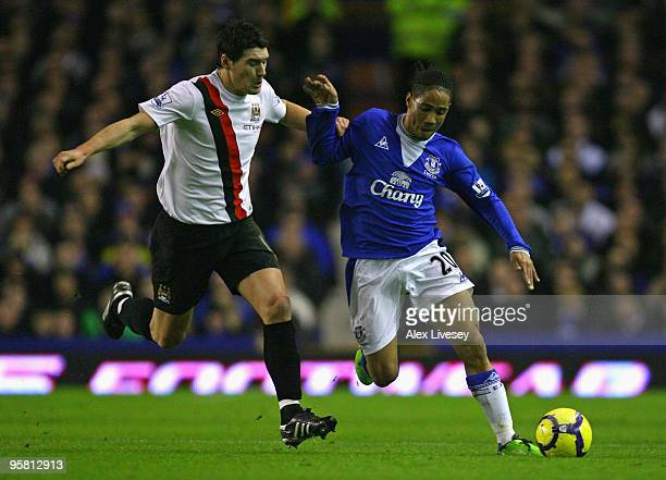 Steven Pienaar of Everton is challenged by Gareth Barry of Manchester City during the Barclays Premier League match between Everton and Manchester...