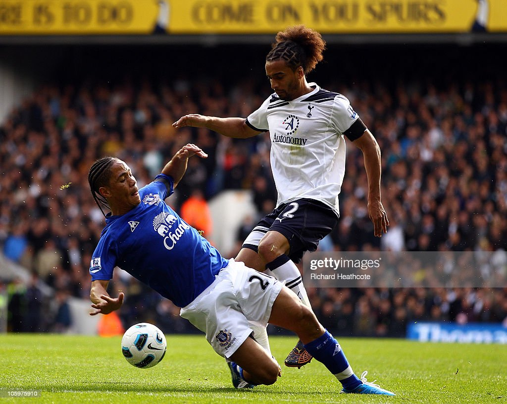<a gi-track='captionPersonalityLinkClicked' href=/galleries/search?phrase=Steven+Pienaar&family=editorial&specificpeople=787271 ng-click='$event.stopPropagation()'>Steven Pienaar</a> of Everton tackles <a gi-track='captionPersonalityLinkClicked' href=/galleries/search?phrase=Benoit+Assou-Ekotto&family=editorial&specificpeople=709848 ng-click='$event.stopPropagation()'>Benoit Assou-Ekotto</a> of Tottenham during the Barclays Premier League match between Tottenham Hotspur and Everton at White Hart Lane on October 23, 2010 in London, England.