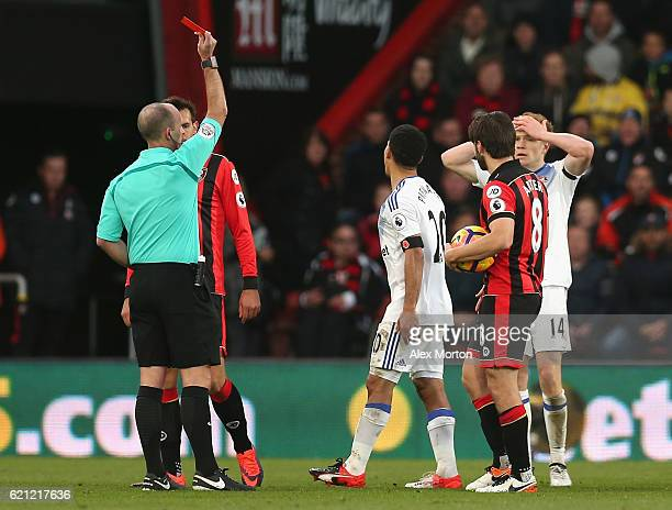 Steven Pienaar of Sunderland is shown a red card by Mike Dean during the Premier League match between AFC Bournemouth and Sunderland at Vitality...
