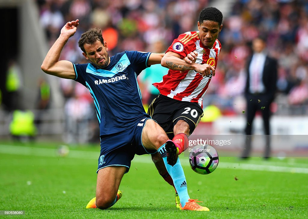 Steven Pienaar of Sunderland is tackled by Christian Stuani of Middlesbrough during the Premier League match between Sunderland and Middlesbrough at Stadium of Light on August 21, 2016 in Sunderland, England.