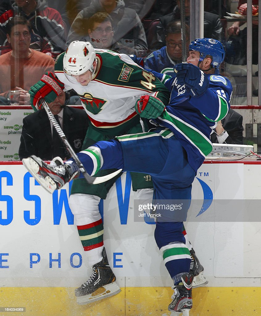 Steven Pinizzotto #13 of the Vancouver Canucks checks <a gi-track='captionPersonalityLinkClicked' href=/galleries/search?phrase=Justin+Falk&family=editorial&specificpeople=4324950 ng-click='$event.stopPropagation()'>Justin Falk</a> #44 of the Minnesota Wild during their NHL game at Rogers Arena March 18, 2013 in Vancouver, British Columbia, Canada.