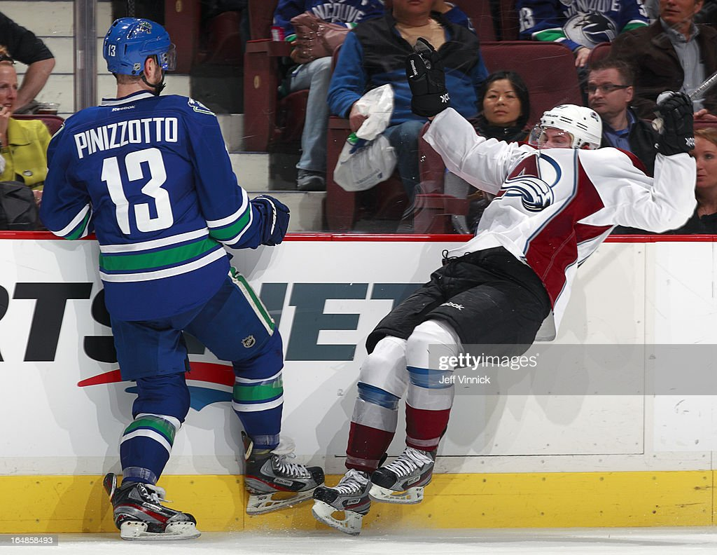 Steven Pinizzotto #13 of the Vancouver Canucks collides with Tyson Barrie #41 of the Colorado Avalanche during their NHL game at Rogers Arena March 28, 2013 in Vancouver, British Columbia, Canada. Vancouver won 4-1.