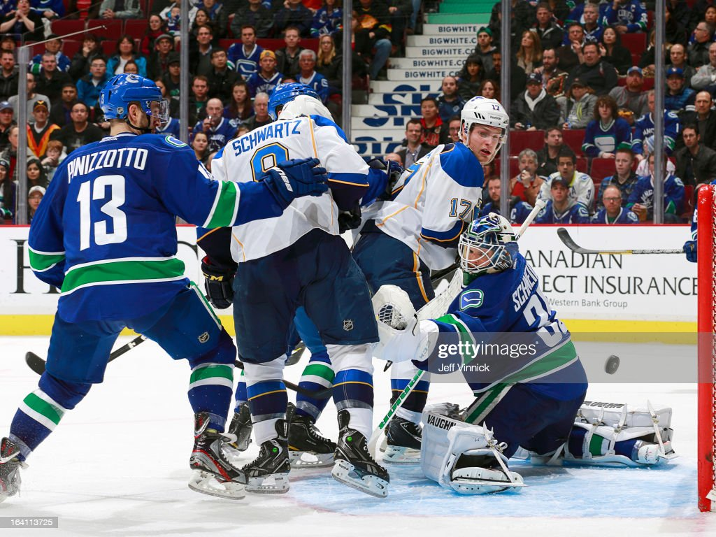 Steven Pinizzotto #13 of the Vancouver Canucks, Jaden Schwartz #9 and <a gi-track='captionPersonalityLinkClicked' href=/galleries/search?phrase=Vladimir+Sobotka&family=editorial&specificpeople=716736 ng-click='$event.stopPropagation()'>Vladimir Sobotka</a> #17 of the St. Louis Blues watch the puck flip behind <a gi-track='captionPersonalityLinkClicked' href=/galleries/search?phrase=Cory+Schneider&family=editorial&specificpeople=696908 ng-click='$event.stopPropagation()'>Cory Schneider</a> #35 of the Canucks during their NHL game at Rogers Arena March 19, 2013 in Vancouver, British Columbia, Canada. Vancouver won 3-2.