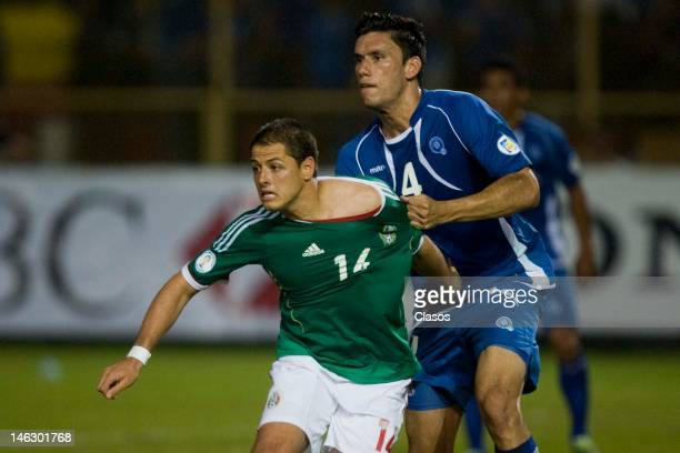Steven Purdi of El Salvador and Javier Hernandez of Mexico fight for a ball during a match between El Salvador and Mexico at Cuscatlan Staduim as...