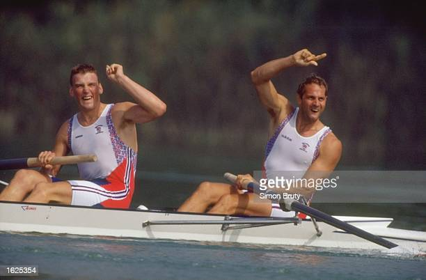 Steven Redgrave and Mathew Pinsent of Great Britain signal victory in the Coxless Pairs rowing event at the 1992 Olympic Games in Barcelona Spain...