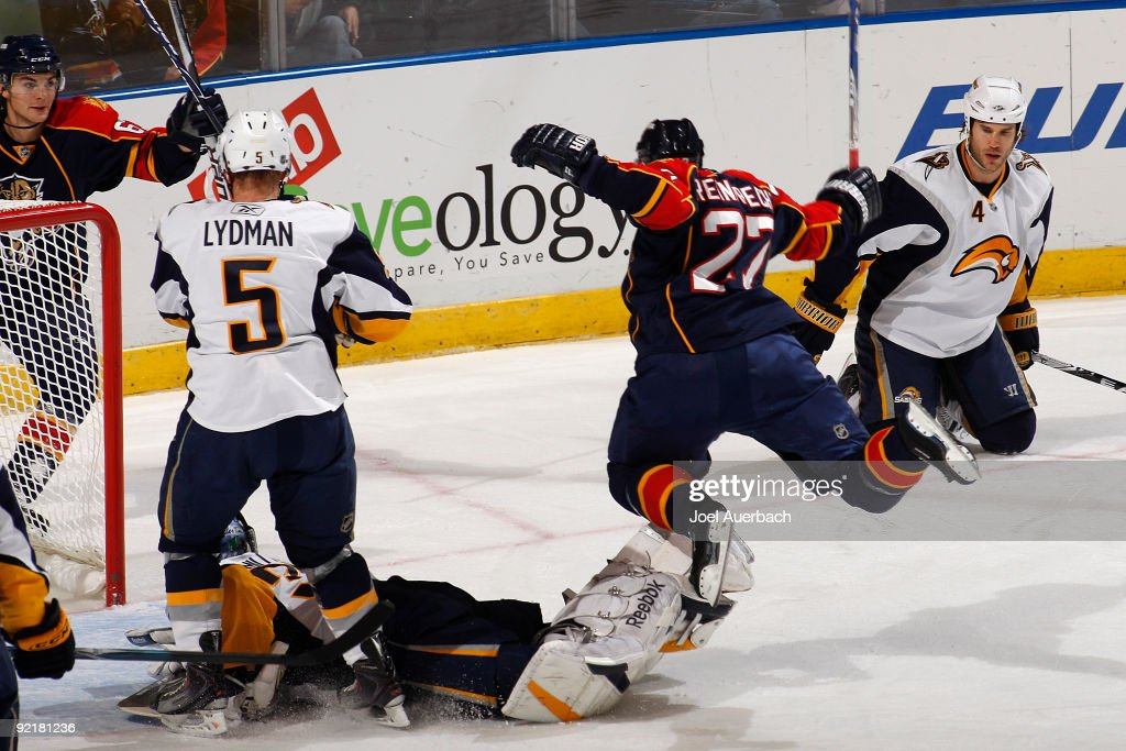 Steven Reinprecht of the Florida Panthers scores a goal past goaltender Ryan Miller of the Buffalo Sabres during the first period on October 21 2009...