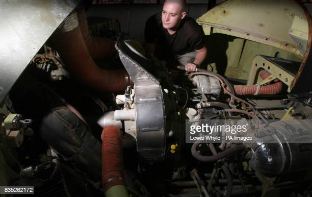 SAC Steven Richardson 24 from Portsmouth works on the gearbox of a Merlin Mk3 military helicopter at Basra airbase in Iraq