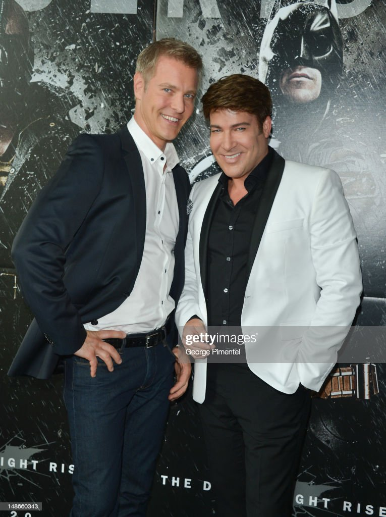 Steven Sabados and <a gi-track='captionPersonalityLinkClicked' href=/galleries/search?phrase=Chris+Hyndman+-+Television+Host&family=editorial&specificpeople=2748149 ng-click='$event.stopPropagation()'>Chris Hyndman</a> attends The Canadian Premiere of 'The Dark Knight Rises' at Scotiabank Theatre on July 18, 2012 in Toronto, Canada.