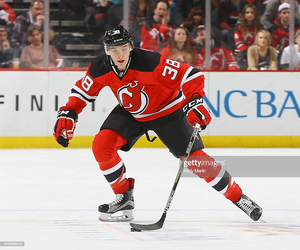 Steven Santini of the New Jersey Devils playing in his first NHL game controls the puck during the game against the Toronto Maple Leafs at Prudential...
