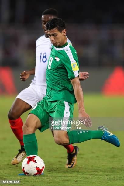 Steven Sessegnon of England battles for the ball with Ali Kareem of Iraq during the FIFA U17 World Cup India 2017 group F match between England and...