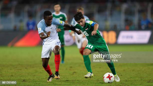Steven Sessegnon of England battles for the ball with Mohammed Ridha of Iraq during the FIFA U17 World Cup India 2017 group F match between England...