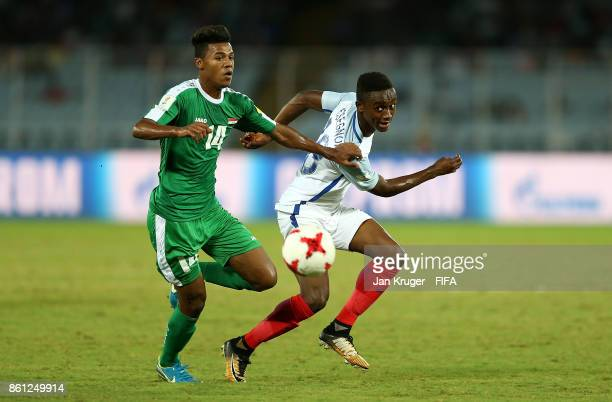 Steven Sessegnon of England steers the ball past Bassam Shakir of Iraq during the FIFA U17 World Cup India 2017 group F match between England and...