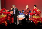 Steven Sinofsky president of Microsoft's Windows division and Ralph Haupter chief executive officer for the China market promote a new tablet...