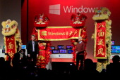 Steven Sinofsky president of Microsoft's Windows division and Ralph Haupter chief executive officer for Microsoft in the China region attend a press...
