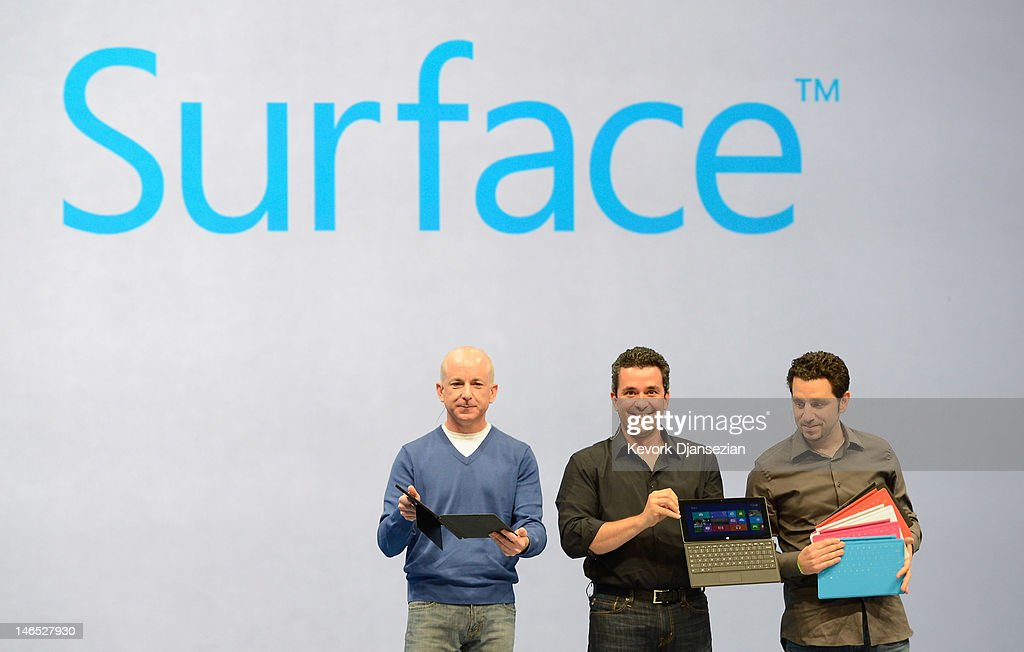 Steven Sinofsky (L), President of Windows, Michael Angiulo (C), Vice President of MS hardware at Microsoft and Panos Panay, General Manger of Surface, holds the tablet Surface by Microsoft during a news conference at Milk Studios on June 18, 2012 in Los Angeles, California. The new Surface tablet utilizes a 10.6 inch screen with a cover that contains a full multitouch keyboard.