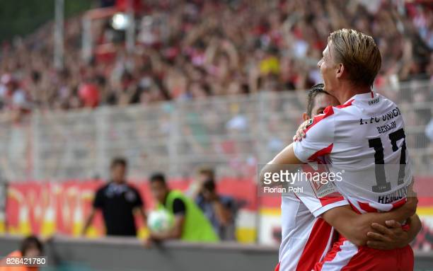 Steven Skrzybski and Simon Hedlund of 1 FC Union Berlin celebrate after scoring the 32 during the game between Union Berlin and Kieler SV Holstein on...