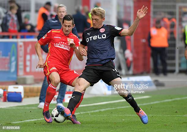 Steven Skrzybski of 1 FC Union Berlin and Axel Bellinghausen of Fortuna Duesseldorf during the game between the 1 FC Union Berlin and Fortuna...