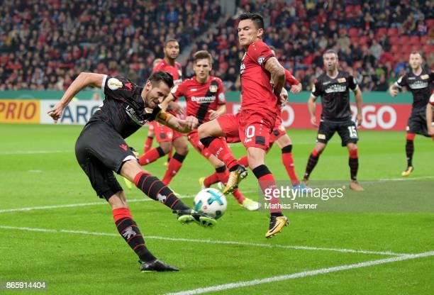 Steven Skrzybski of 1 FC Union Berlin and Charles Aranguiz of Bayer 04 Leverkusen during the game between Bayer 04 Leverkusen and Union Berlin on...
