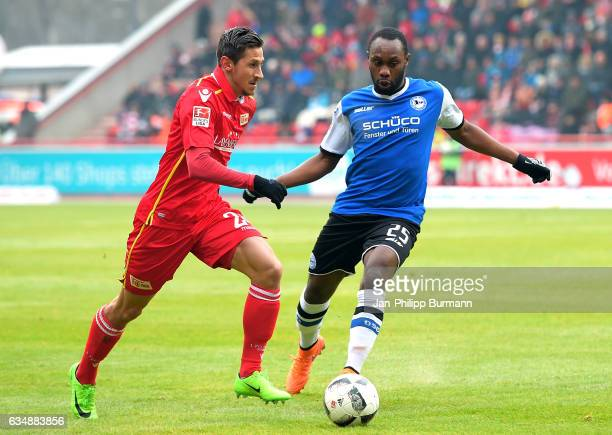 Steven Skrzybski of 1 FC Union Berlin and Reinhold Yabo of Arminia Bielefeld during the game between dem 1 FC Union Berlin and DSC Arminia Bielefeld...