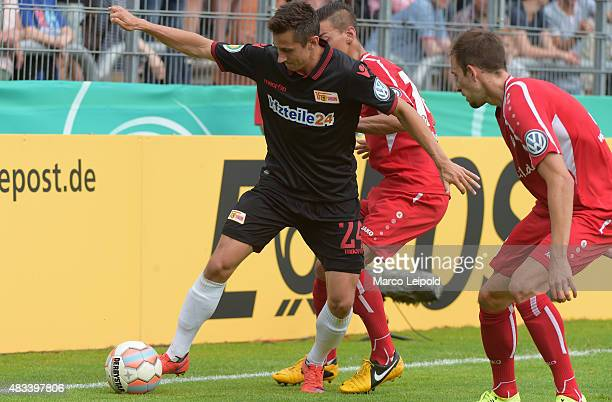 Steven Skrzybski of 1 FC Union Berlin and Roberto Guirino of FC Viktoria Koeln during the DFB Cup match between FC Viktoria Koeln and Union Berlin at...