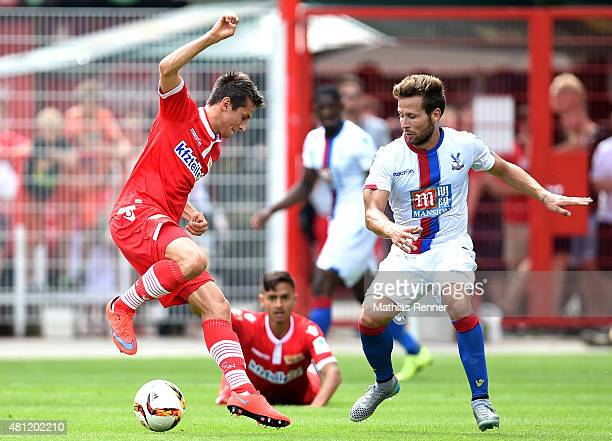Steven Skrzybski of 1 FC Union Berlin and Yohan Cabaye of Crystal Palace during the friendly match between Union Berlin and Crystal Palace on July 18...