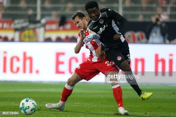 Steven Skrzybski of Berlin battles for the ball with Manfred Osei Kwadwo of Kaiserslautern during the Second Bundesliga match between 1 FC Union...