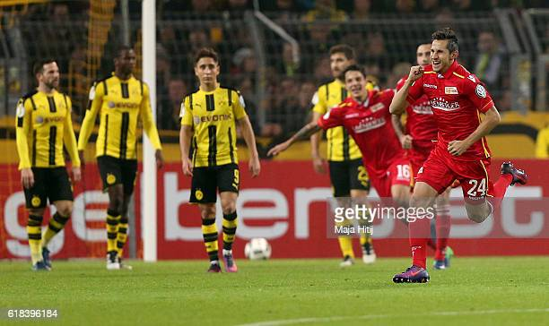 Steven Skrzybski of Berlin celebrates after he scores the equalizing goal during DFB Cup second round match between Borussia Dortmund and 1 FC Union...