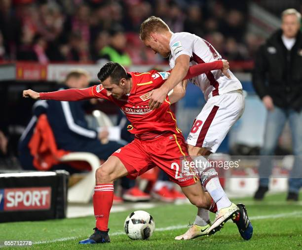 Steven Skrzybski of Berlin is challenged by Hanno Behrens of Nuernberg during the Second Bundesliga match between 1 FC Union Berlin and 1 FC...