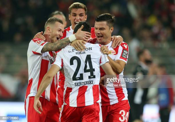 Steven Skrzybski of Berlin jubilates with team mates after scoring the fourth goal during the Second Bundesliga match between 1 FC Union Berlin and 1...