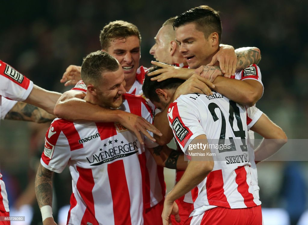 Steven Skrzybski (C) of Berlin jubilates with team mates after scoring the fourth goal during the Second Bundesliga match between 1. FC Union Berlin and 1. FC Kaiserslautern at Stadion An der Alten Foersterei on September 25, 2017 in Berlin, Germany.