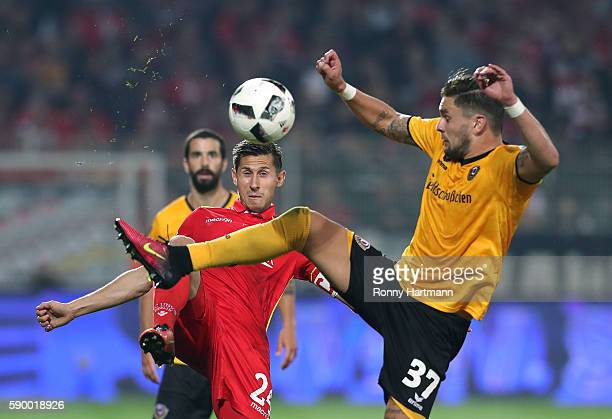 Steven Skrzybski of Berlin vies with Pascal Testroet of Dresden during the Second Bundesliga match between 1 FC Union Berlin and SG Dynamo Dresden at...