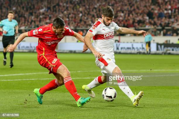 Steven Skrzybski of Union Berlin and Emiliano Adriano Insua of Stuttgart battle for the ball during the Second Bundesliga match between VfB Stuttgart...