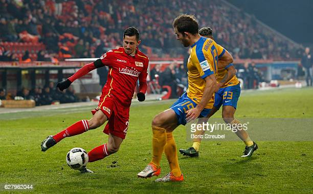 Steven Skrzybski of Union Berlin is challenged by Ken Reichel of Eintracht Brauschweig during the Second Bundesliga match between 1 FC Union Berlin...