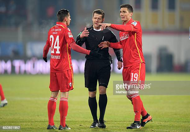 Steven Skrzybski referee Patrick Ittrich and Damir Kreilach of 1 FC Union Berlin during the game between Union Berlin and VFL Bochum on January 27...