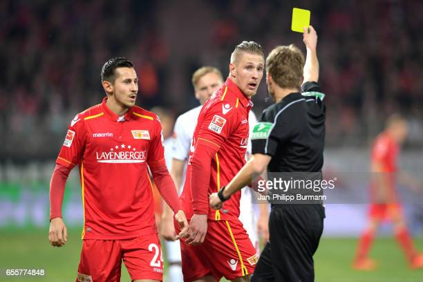 Steven Skrzybski Sebastian Polter of 1FC Union Berlin and referee Dr Jochen Drees during the game between 1 FC Union Berlin and 1 FC Nuernberg on...